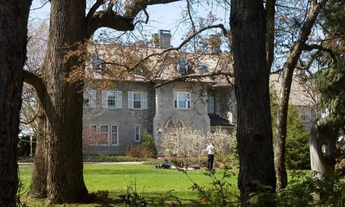 A gardener works on the grounds at the Prime Minister's residence at 24 Sussex Drive in Ottawa, May 6, 2008. Nearly four years after Justin Trudeau opted not to move into the prime minister's official residence over concerns about its crumbling state, the building remains vacant short of staff who continue to use the kitchen to prepare meals for Trudeau and his family. (Tom Hanson/The Canadian Press)