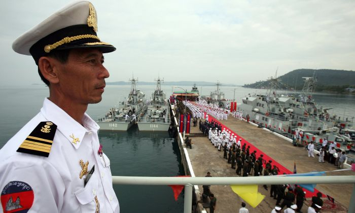 A Cambodian naval personnel stands on a naval patrol boat during a ceremony for nine naval patrol boats that were donated by China, at the Cambodia Naval Base in Sihanoukville, some 220 kilometers south-west of Phnom Penh, on 07 November 2007. (TANG CHHIN SOTHY/AFP/Getty Images)