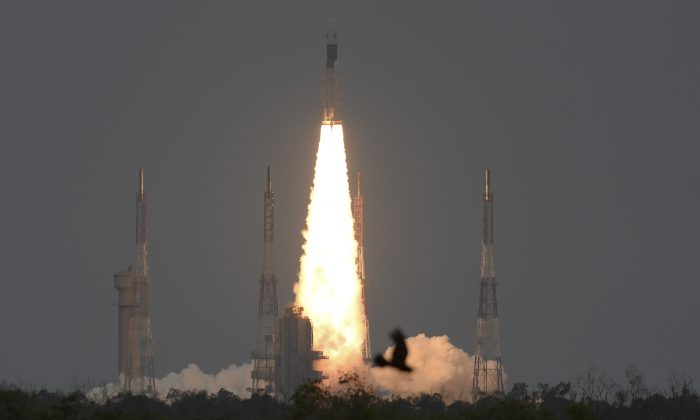 The Indian Space Research Organisation's (ISRO) Chandrayaan-2 (Moon Chariot 2), with on board the Geosynchronous Satellite Launch Vehicle (GSLV-mark III-M1), launches at the Satish Dhawan Space Centre in Sriharikota, an island off the coast of southern Andhra Pradesh state, on July 22, 2019. (Arun Sankar/AFP/Getty Images)