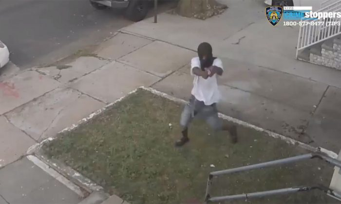 Screen image from video showing a gunman attempting to shoot a female victim in New York City Friday. (NYPD)