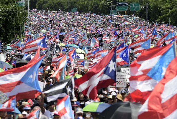 Demonstrators march on Las Americas highway demanding the resignation of governor Ricardo Rossello