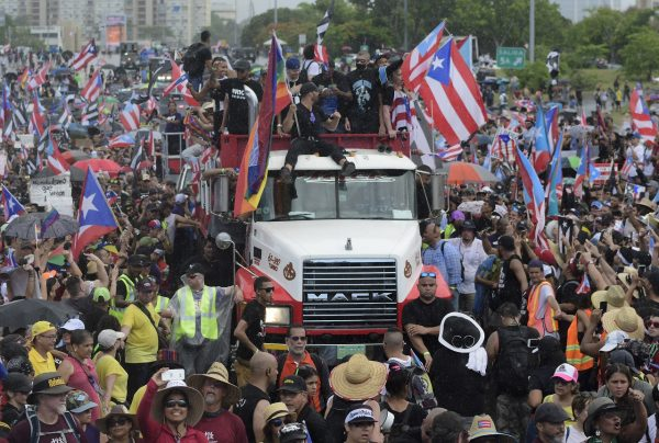 Puerto Rican singer Ricky Martin, front atop truck, participates with other local celebrities in a protest demanding the resignation of governor Ricardo Rossello in San Juan,