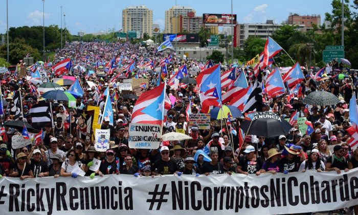 Thousands of Puerto Ricans gather for what many are expecting to be one of the biggest protests ever seen in the U.S. territory, with irate islanders pledging to drive Gov. Ricardo Rossello from office, in San Juan, Puerto Rico, on July 22, 2019. (Carlos Giusti/AP Photo)
