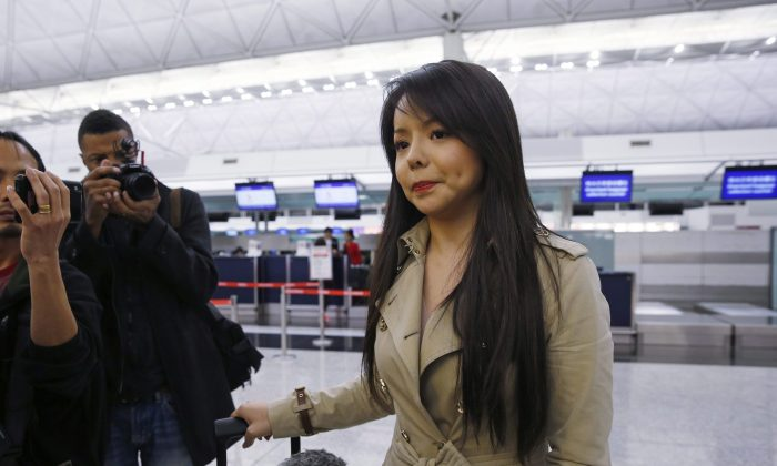 Canada's Miss World 2015 contestant Anastasia Lin speaks to media at Hong Kong International Airport after she was denied entry to mainland China for the pageant finals, on Nov. 26, 2015. (AP Photo/Kin Cheung)