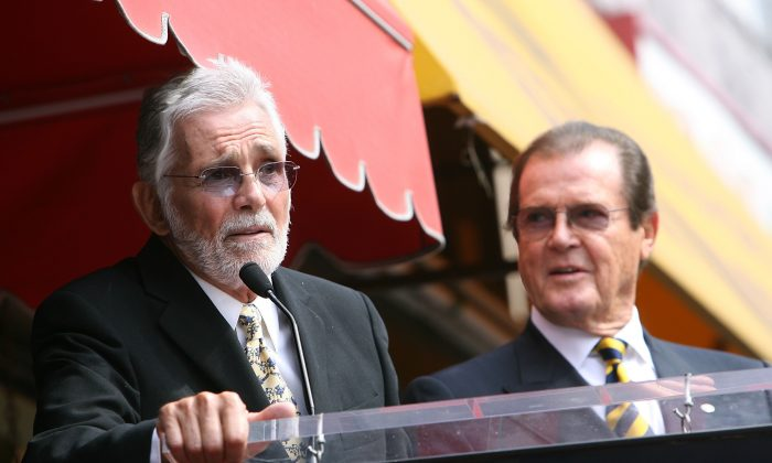 Actor David Hedison (L) speaks as British actor Sir Roger Moore (R) is honored with a Star on the Hollywood Walk of Fame in Hollywood, California, on Oct. 11, 2007. (Michael Buckner/AFP/Getty Images)