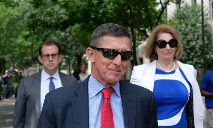 Michael Flynn and his lawyer, Sidney Powell, leave the E. Barrett Prettyman U.S. Courthouse in Washington on June 24, 2019. (Alex Wroblewski/Getty Images)