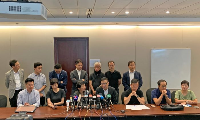 A press conference held by pan-democratic councilors condemning police giving allowances for the suspected mafia to assault local residents. (Poon Zaishu/The Epoch Times)