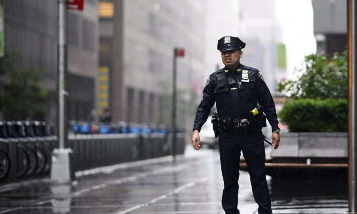 A policeman looks down a street in midtown Manhattan in New York on June 10, 2019. (Johannes Eisele/AFP/Getty Images)