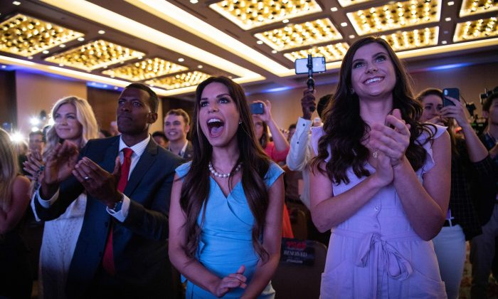 Supporters of President Donald Trump cheer as he appears on stage before addressing the Turning Point USAs Teen Student Action Summit in Washington, on July 23, 2019. (Nicholas Kamm/AFP/Getty Images)