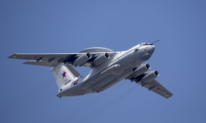 A Russian Beriev A-50 airborne early warning and control training aircraft flies over Red Square during a rehearsal for the Victory Day military parade in Moscow, Russia, on May 7, 2019. (Alexander Zemlianichenko/ AP Photo)