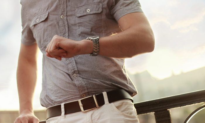 A man checks his watch. Being conscious of how we are using our time can help us be more productive and self-disciplined. (Jan Vašek/Pixabay)