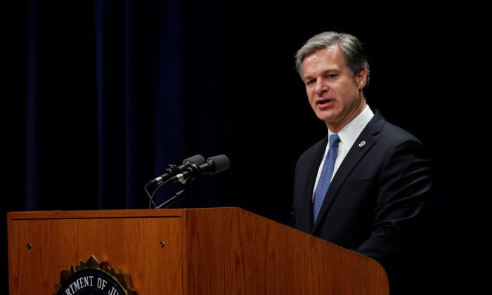 FBI Director Christopher Wray speaks at the FBI National Academy Graduation Ceremony in Quantico, Virginia, U.S., June 7, 2019 (Reuters/Tom Brenner/File Photo).