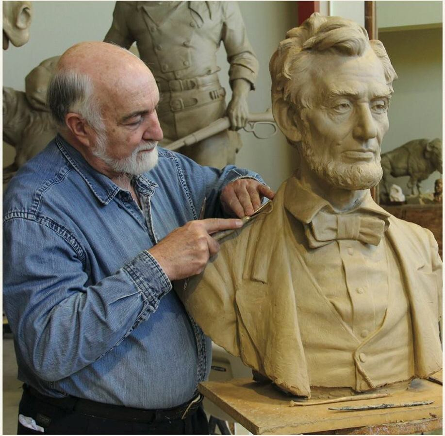 Ed Fraughton with a sculpture of Lincoln