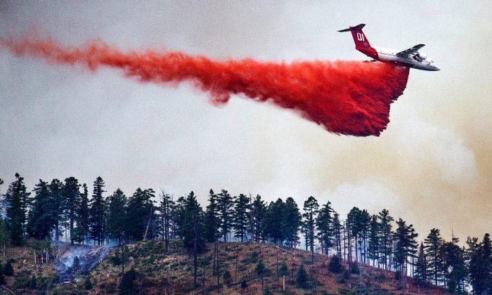 An air tanker drops retardant on a ridge overlooking the North Peak neighborhood as the Museum Fire burns north of Flagstaff, Ariz., on July 22, 2019. (Tom Tingle/The Arizona Republic via AP)