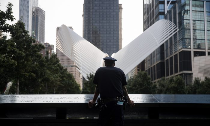 In this file image, an NYPD officer pauses at the National September 11 Memorial, September 11, 2017 in New York City. (Drew Angerer/Getty Images)