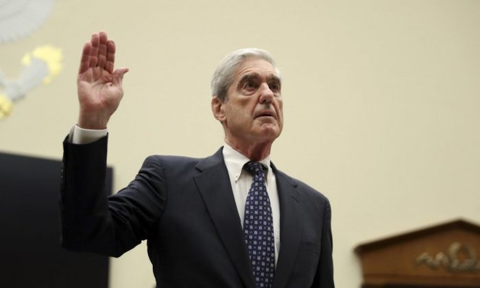 Former special counsel Robert Mueller, is sworn in before he testifies before the House Judiciary Committee hearing on his report on Russian election interference, on Capitol Hill, in Washington, on July 24, 2019. (AP Photo/Andrew Harnik)