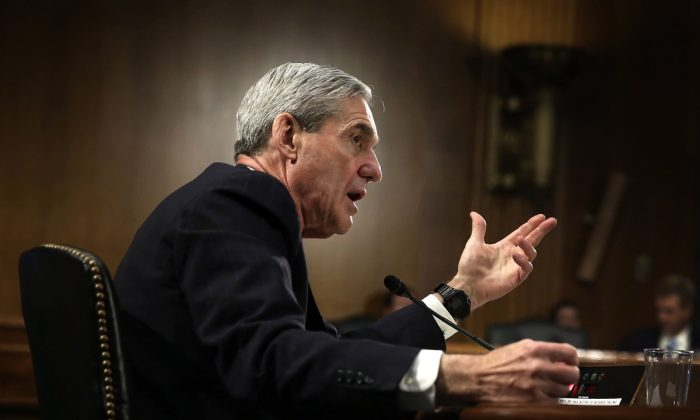 Former FBI Director Robert Mueller testifies during a hearing before the Senate Judiciary Committee on Capitol Hill in Washington on June 19, 2013. (Alex Wong/Getty Images)