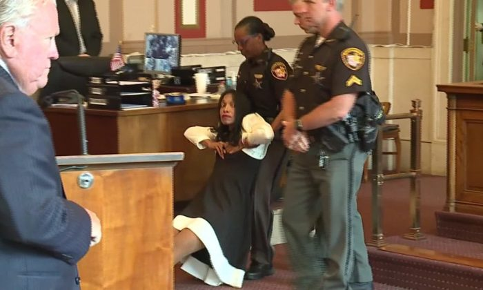 Former judge Tracie Hunter was dragged out of an Ohio courtroom after being sentenced. (WLWT via CNN)