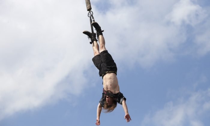 A bungee jumper in Kostrzyn, Poland on Aug. 4, 2017. (Omer Messinger/Getty Images)