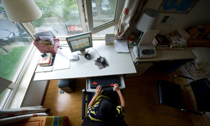A boy using a computer in his room in China. (Ed Jones/AFP/GettyImages)