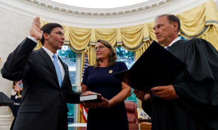 Mark Esper, left, is sworn in as the Secretary of Defense by Supreme Court Justice Samuel Alito, right, at the White House in Washington, on July 23, 2019. (Carolyn Kaster/AP Photo)