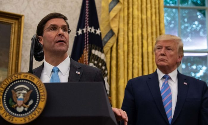 US Defense Secretary Mark Esper speaks after he was sworn in as President Donald Trump looks on in the Oval Office at the White House in Washington, on July 23, 2019. (Nicholas Kamm/AFP/Getty Images)