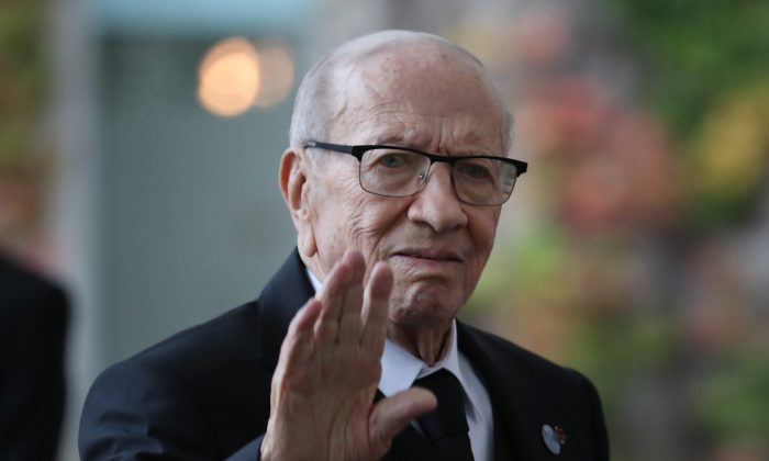 "President of Tunisia Beji Caid Essebsi waves as he arrives at the Chancellery during the ""Compact with Africa"" conference in Berlin, Germany on Oct. 30, 2018. (Sean Gallup/Getty Images)"