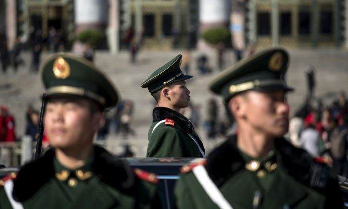 Paramilitary police officers stand in front of the Great Hall of the People during the opening of the National People's Congress in Beijing on Mar. 5, 2017.  (Fred Dufour/AFP/Getty Images)