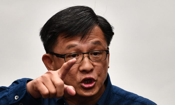 Pro-Beijing lawmaker Junius Ho speaks during a press conference in a meeting room of the Legislative Council in Hong Kong on July 22, 2019. (ANTHONY WALLACE/AFP/Getty Images)
