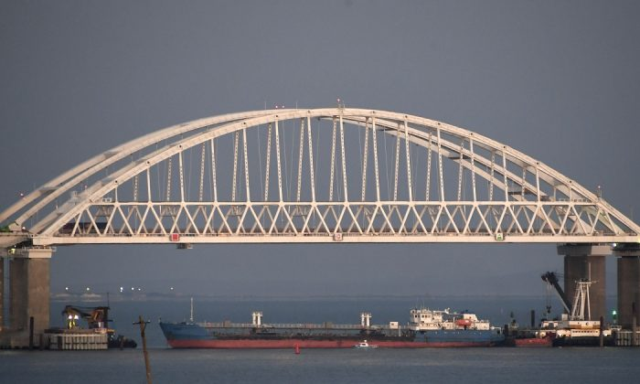 A Russian tanker under the the Kerch bridge blocks the passage to the Kerch Strait near Kerch, Crimea, on Nov. 25, 2018. (AP Photo)
