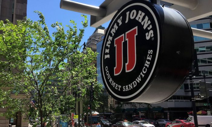 A logo of the sandwich restaurant chain, specializing in delivery Jimmy John's hangs outside one of their shops in downtown Washington, DC, on June 9, 2016. (Mladen Antonov        /AFP/Getty Images)