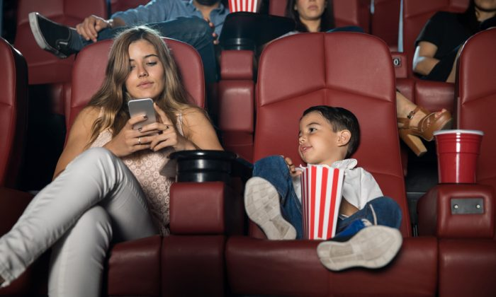Perhaps you've noticed yourself increasingly annoyed when your children 'interrupt' what you're looking at on your phone.  (ANTONIODIAZ/SHUTTERSTOCK)