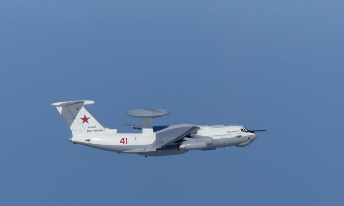 A Russian A-50 military aircraft flies near the disputed islands called Takeshima in Japan and Dokdo in South Korea, in this handout picture taken by Japan Air Self-Defence Force and released by the Joint Staff Office of the Defense Ministry of Japan on July 23, 2019. (Joint Staff Office of the Defense Ministry of Japan/HANDOUT via REUTERS)