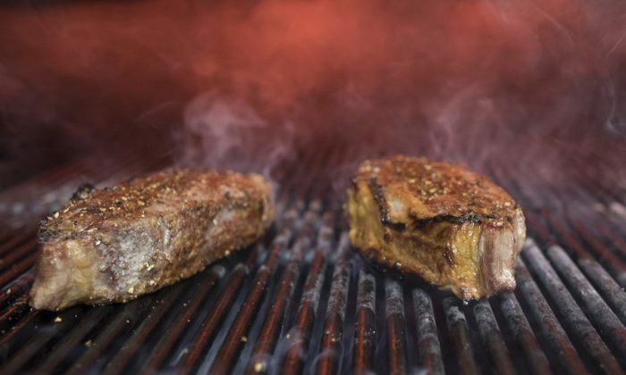 Steaks on a grill in New York. (Mary Altaffer, File/AP Photo)