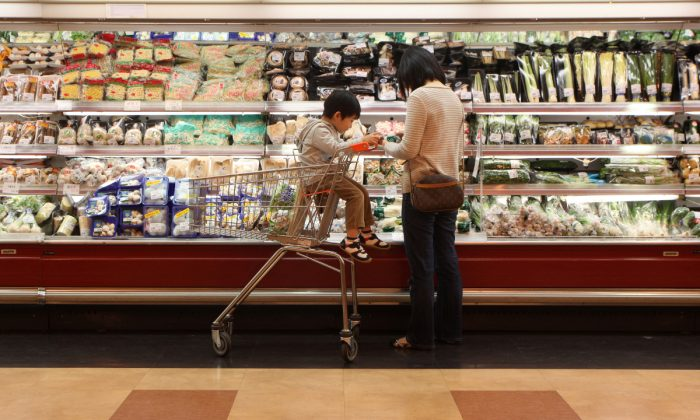 A woman and boy in a supermarket in China. (Ed Jones/AFP/Getty Images)
