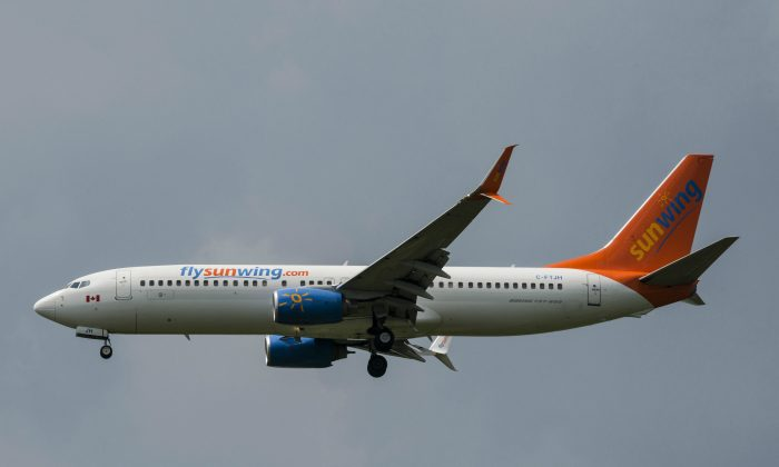 A Sunwing Boeing 737-800 passenger plane prepares to land at Pearson International Airport in Toronto on August 2, 2017. (Christopher Katsarov/The Canadian Press)