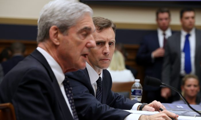 Former Deputy Special Counsel Aaron Zebley (R) listens to former Special Counsel Robert Mueller testify before the House Judiciary Committee on July 24, 2019. (Chip Somodevilla/Getty Images)