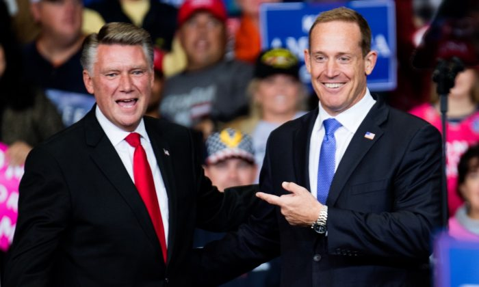 Republican Congressional candidate for North Carolina's 13th district Ted Budd (R), and 9th district Mark Harris (L) are introduced by President Donald Trump during a campaign rally at the Bojangles Coliseum in Charlotte, N.C., on Oct. 26, 2018. (Sean Rayford/Getty Images)