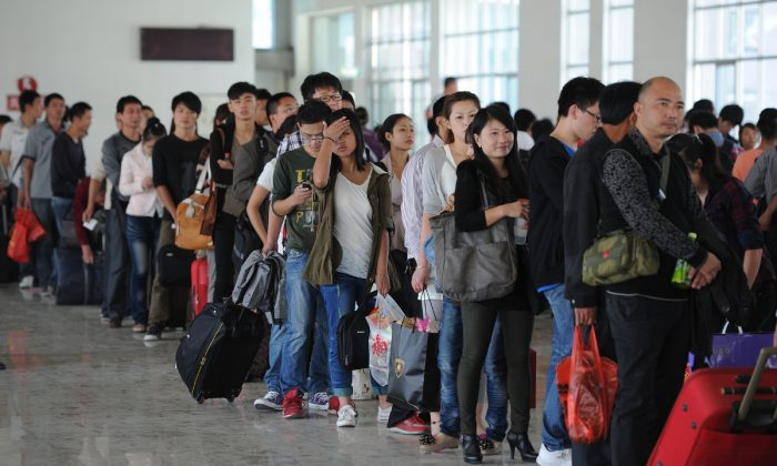 Passengers line up at a train station in China. (AFP/AFP/GettyImages)