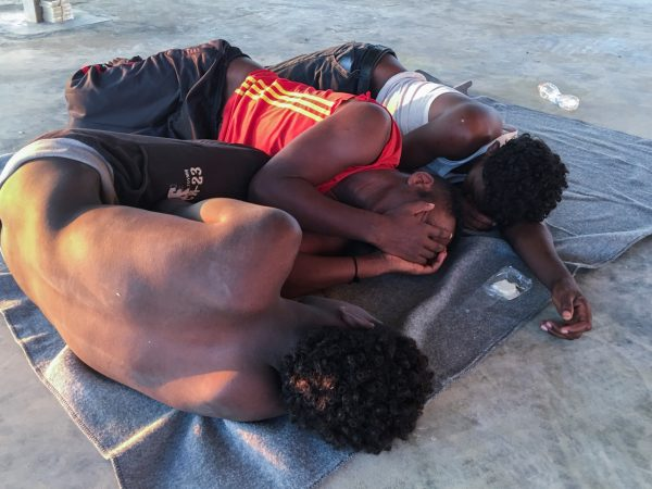 rescued migrants capsized boat