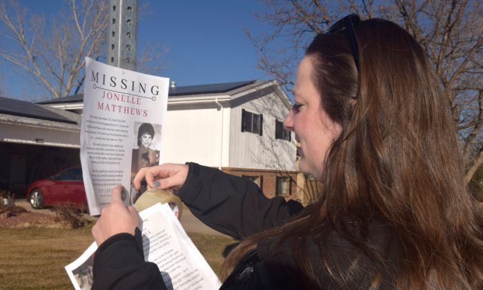 A victims advocate posts a flyer of a missing persons poster for Jonelle Matthews in Greeley, Colo., in December 2018. (Joe Moylan/The Greeley Tribune via AP)