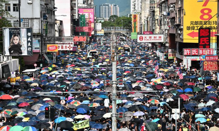 Protesters demonstrate in the district of Yuen Long in Hong Kong on July 27, 2019. Crowds of Hong Kong protesters defied a police ban and began gathering in a town close to the Chinese border to rally against suspected triad gangs who beat up pro-democracy demonstrators there. (Anthony Wallace/AFP/Getty Images)