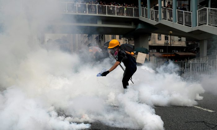 A demonstrator reacts to a tear gas during a protest against the Yuen Long attacks in Yuen Long, New Territories, Hong Kong, China on July 27, 2019. (Tyrone Siu/Reuters)