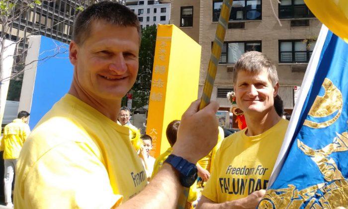 Nick and Simon Vereshaka at a Falun Dafa parade in New York in May 2018. (Courtesy of Nick Vereshaka)