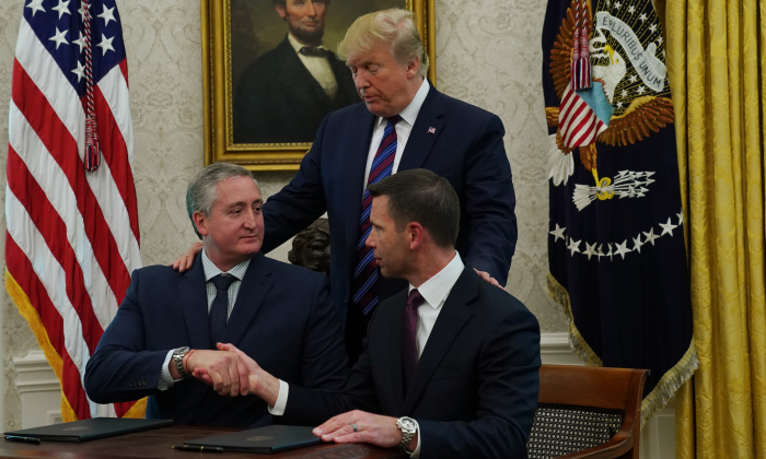 Acting U.S. Secretary of Homeland Security Kevin McAleenan shakes hands with Interior Minister of Guatemala Enrique Degenhart as U.S. President Donald Trump looks on after they signed a safe third country agreement in the Oval Office of the White House in Washington on July 26, 2019. (Alex Wong/Getty Images)