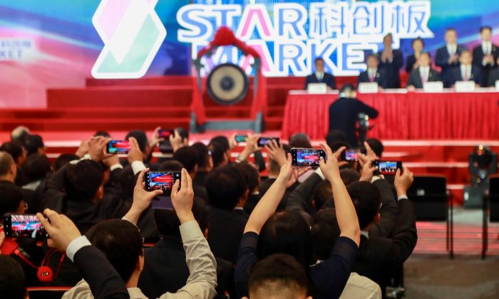 People take pictures during the opening ceremony of the Shanghai Stock Exchange's Sci-Tech Innovation Board (STAR) in Shanghai on July 22, 2019. (STR/AFP/Getty Images)