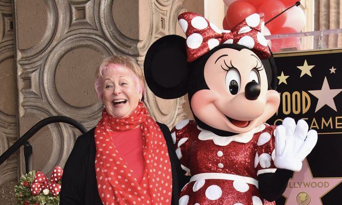 Voice actress Russi Taylor, who has voiced Minnie Mouse since 1986, poses with Minnie Mouse during a star ceremony in celebration of the 90th anniversary of Disney's Minnie Mouse at the Hollywood Walk of Fame on Jan. 22, 2018 in Hollywood, California.  (Alberto E. Rodriguez/Getty Images)