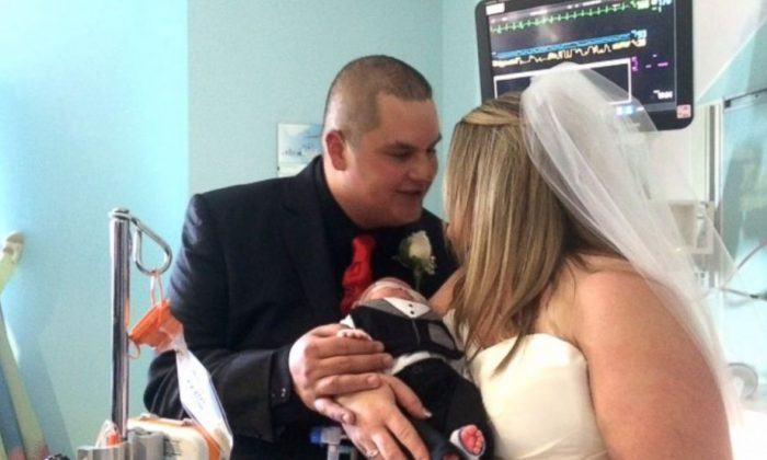Kristi Warriner and Justin Nelson hold their baby, J.J., during their wedding ceremony at Cook Children's Hospital in Texas. (Courtesy Cook Childrens Hospital)
