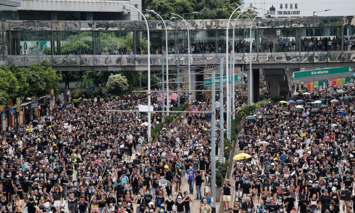 Pro-democracy protesters march to protest against police violence during previous marches, in central Hong Kong, on July 28, 2019. (Tyrone Siu/Reuters)