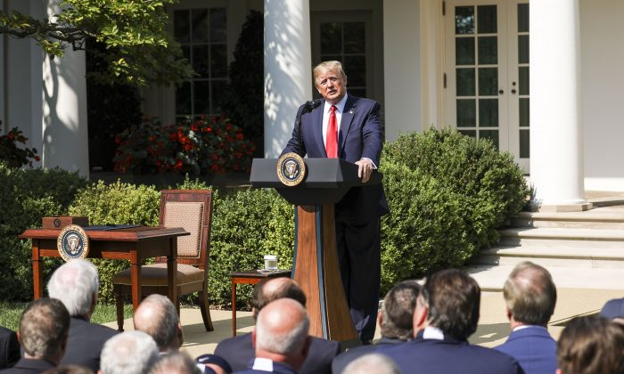 President Donald Trump speaks at the signing of the 9/11 Victim Compensation Fund bill in the White House Rose Garden on July 29, 2019. (Charlotte Cuthbertson/The Epoch Times)